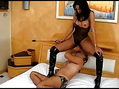 Transsexual Dominatrix predominates boy