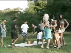 Brown-haired shemale in outdoor gang-bang