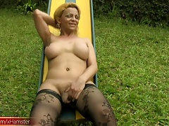 Blonde  with gigantic boobs and bootie jacks off outdoors