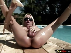 Pansy tgirl takes off by the pool and oiles up her stellar assets