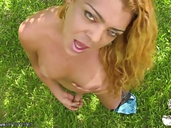 Curly hair t-girl poses outdoors and  huge butt in g-string
