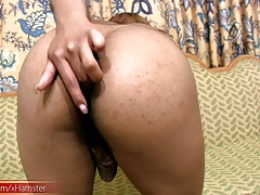 Chubby  she-creature tugs lotion decorated penis and huge booty