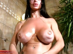 Mature tranny in jaw-dropping  attire strokes bigtits and t-dick