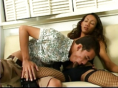 Japanese tgirl in  leather gets throated and torn up by boy on couch